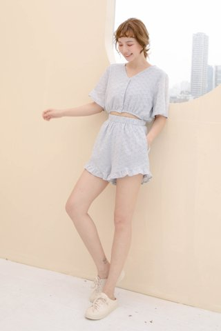 BUTTER BAKERY EYELET ROMPER IN BABY BLUE